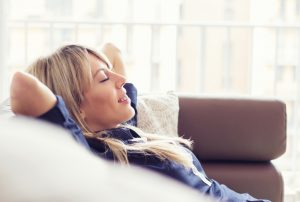 comfortable-woman-on-couch